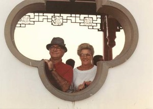 Congressman John Joseph Moakley and Evelyn Moakley looking out of a Chinese style building on a congressional trip to China
