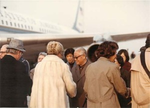Congressman John Joseph Moakley, Evelyn Moakley, and others are greeted by Chinese officials at the airport during a congressional trip to China