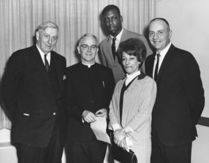 Suffolk University President John E. Fenton (1965-1970) with Father Egan and others at a campus event