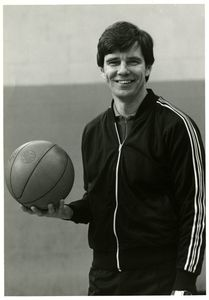 Suffolk University Athletics Director James E. Nelson holding basketball, portrait
