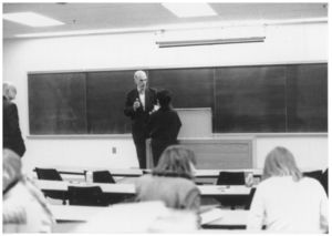 Suffolk University Professor Herbert Lemelman (Law) speaks with a student in classroom