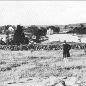 Mr. John B. Hill standing on the Green lands looking north toward the old cornmill