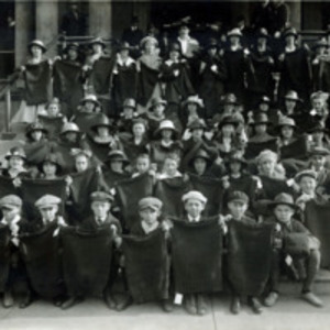 [Children with hand knit sweaters for soldiers]