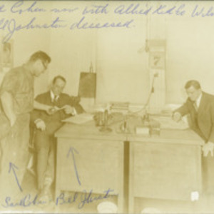 Men around desk