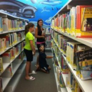 Family using the Saugus Public Library
