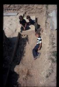 Skeletal remains with children at trench 14, 1972