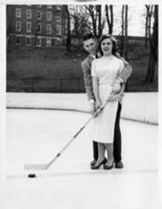 Student with date on Ice Hockey Rink, 1957