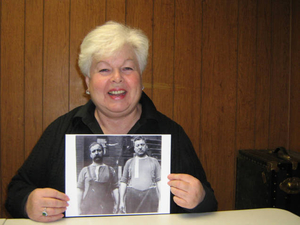 Cate Ryan holding a photograph of her grandfather Joseph Kerans and her great-uncle Edward Kerans
