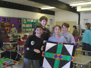 6th grade math class learns symmetry through quilting