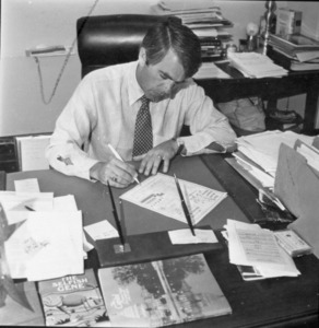 Sheet of photographs of Paul E. Tsongas at a desk