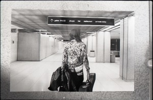 Young woman with a guitar case walking through an airport, a copy of Free Spirit Press (vol. 1, 4) in her back pocket: manipulated copy print inserting background of airport