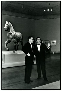 Two men in front of a San Marco Horse