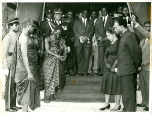 Nana Nketsi pouring libations to the gods of Africa, Kwame Nkrumah, Shirley Graham Du Bois, and others with heads bowed