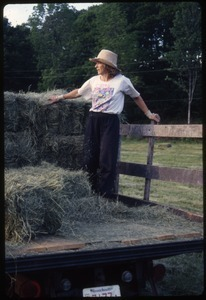 Nina Keller on hay truck, Wendell Farm
