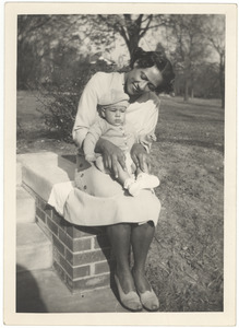 Unidentified woman possibly holding Ellen Long