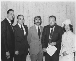 Robert L. Gluckstern standing with group