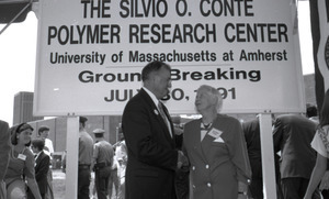 Ceremonial groundbreaking: unidentified official shaking hands with Corinne Conte