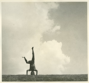 Boy standing on head, July 4th