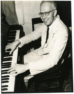 W. L. Holland at the piano
