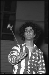 Abbie Hoffman in his American flag shirt, playing with a yo yo
