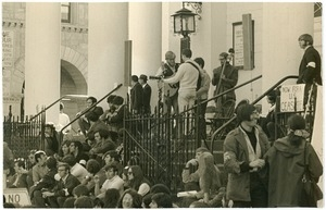 Anti-Vietnam War protesters from Work For Peace on the steps of the First Congregational Church, a folk band playing at the top