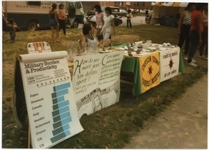 AFSC table at the North End Fair offering information opposing militarism and defense spending