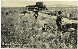 Whippet tank in action, troops digging in, France