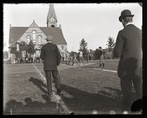 Kickoff to a football game near Old Chapel, Massachusetts Agricultural College