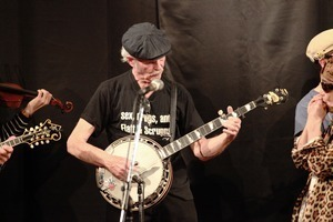 Jim Kweskin Jug Band performing in Japan: Bill Keith on banjo (wearing t-shirt reading 'Sex, drugs, and Flatt & Scruggs')