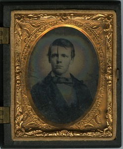 Homer Dickinson: half-length studio portrait