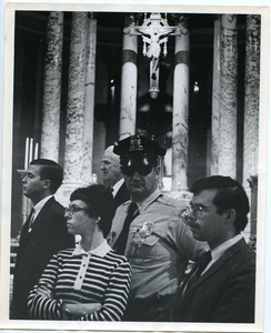 James Forest (right), later arrested with the Milwaukee 14, and 2 others with a policeman inside of St. John's Cathedral after the eight people had been arrested