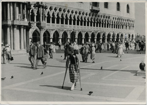Pat Spaulding walking on crutches through the Piazza San Marco, Venice