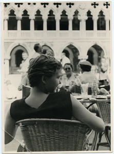 Pat Spaulding seated at a cafe in Venice