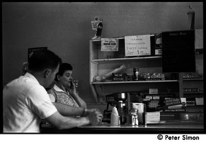 Customer and waitress at the counter of a diner