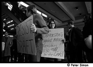 Demonstration against Marine recruiters: protesters carrying signs reading 'Resist the draft' and 'Demonstrate against Marine recruiters'