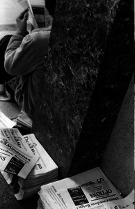 Piles of student newspaper The Minutemen, UMass Amherst, with headline 'Does Freedom Reign? CIA. . . where your opinions are as diverse as your interests'