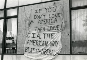 Banners hanging on building (possibly Beta Kappa Phi frat) at UMass Amherst reading 'If you don't love American then leave!' and 'CIA the American way, Beat it liberals'