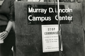 Handbill posted on podium reading 'Stop Communism / a protest of the Soviet Union / Sponsored by the UMass Republican Club,' UMass Amherst