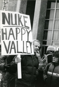 Right wing protester at UMass Amherst with placard reading 'Nuke Happy Valley'