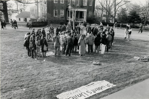 Rally near Whitmore Hall, UMass Amherst, with banners reading 'CIA out of UMass' and 'Students united will never be defeated'