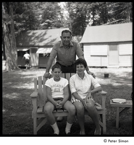 Camp Arcadia: camper seated with his parents