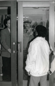 Woman greeted at door of Whitmore Hall, UMass Amherst, by police officer and official