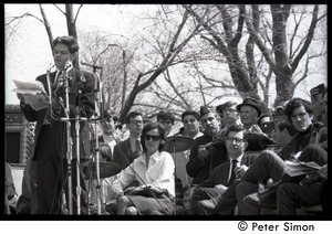 Resistance on the Boston Common: Staughton Lynd addressing the crowd with Terry Cannon (far right) and Noam Chomsky (2d from right) seated on stage