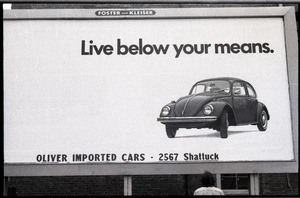 Billboard advertit for a Volkswagen Beetle: 'Live below your ...