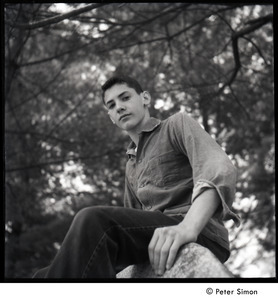 Camp Arcadia: portrait of a camper seated on a rock