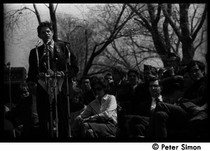 Resistance on the Boston Common: Staughton Lynd addressing the crowd, Noam Chomsky (2d from right) and Terry Cannon (far right) on stage