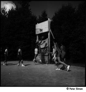 Camp Arcadia: campers playing basketball (driving for a layup)
