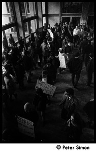 Demonstration against Marine recruiters: crowd in Boston University Student Union, protesters with antidraft and antiwar placards