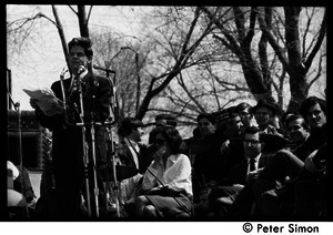 Resistance on the Boston Common: Staughton Lynd addressing the crowd; Noam Chomsky (2nd from right) and Terry Cannon (far right) waiting on stage