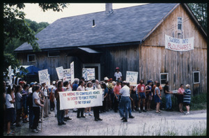 Supporters of war tax resisters Randy Kehler and Betsy Corner demonstrating at the Colrain house